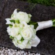 Bridal bouquet on the concrete parapet — Stock Photo