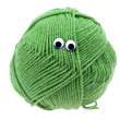 Skein of wool  with eyes isolated on white - Stok fotoğraf