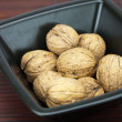 Stock Photo: Walnuts in bowl on bamboo mat