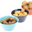 Stock Photo: Nuts in bowls isolated on white
