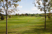 Golf course against the blue sky — Stock Photo