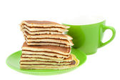 Pancakes on a plate and cup isolated on white — Stock Photo