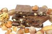 Chocolate bar and nuts isolated on white — Stock Photo