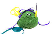 Skein of wool with eyes, ribbon, scissors and crochet hooks isol — Stock Photo