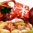 Dish, cookies, nuts, apple, bows, boxes, gifts, Christmas balls — Stock Photo #6092953