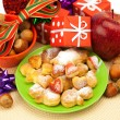Royalty-Free Stock Photo: Dish, cookies, nuts, apple, bows, boxes, gifts, Christmas balls