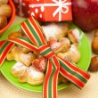 Dish, cookies, nuts, apple, bows, boxes, gifts, Christmas balls — 图库照片