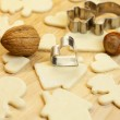 Cut dough snowman, house, nuts, heart and forms for the cookies — Stock Photo #6093240
