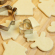 Cut dough snowman, house, heart, and forms for cookies — Stock Photo #6093255