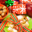 Dish, cookies, nuts, apple, bows, boxes, gifts, Christmas balls — Photo