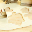Cut dough snowman, house, heart, and forms for cookies — Stock Photo #6093510