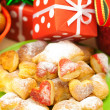 Dish, cookies, nuts, apple, bows, boxes, gifts, Christmas balls — Stock Photo #6093600