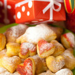 Dish, cookies, nuts, apple, bows, boxes, gifts, Christmas balls — Стоковая фотография