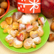 Dish, cookies, nuts, apple, bows, boxes, gifts, Christmas balls — Stock Photo #6093630