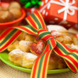 Dish, cookies, nuts, apple, bows, boxes, gifts, Christmas balls — Stock Photo #6093643