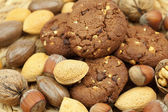 Oatmeal cookies and nuts in a wicker mat — Stock Photo