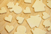 Cut in the dough snowman, heart, and house — Stockfoto