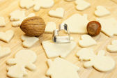 Cut dough snowman, house, nuts, heart and forms for the cookies — Stock Photo