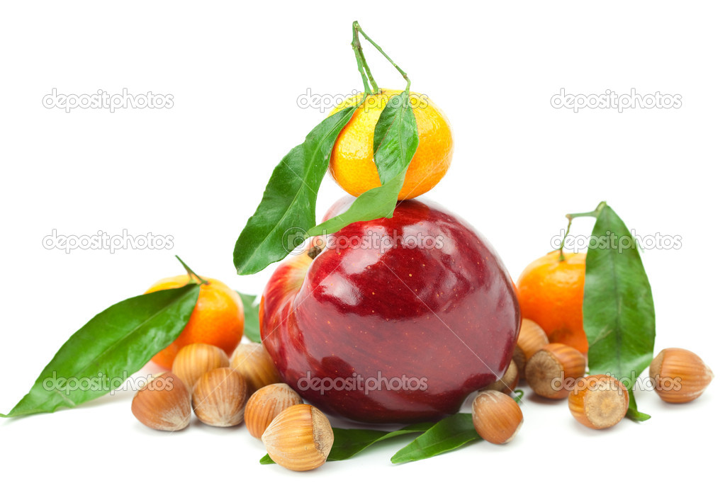 Red apple, mandarin  with green leaves and nuts  isolated on white — Stock Photo #6093800