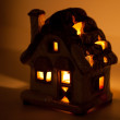 Royalty-Free Stock Photo: A decorative house with a candle inside