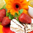 Lemon tea ,lemon,gerbera,cake and strawberries lying on the oran — Stockfoto