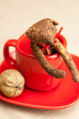 Teddy bear handmade in a cup and nuts — Stock Photo