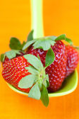 Strawberries in a spoon of the orange fabric — Stock Photo