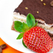 Stock Photo: Cake and strawberries lying on orange fabric