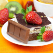 Stock Photo: Lemon tea,chocolate, kiwi,cake and strawberries lying on ora