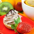 Stock Photo: Lemon te,lemon,mandarin.kiwi,cake and strawberries lying on th