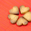 Cookie in the form of heart in a plate on a red background — Stock Photo