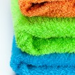 Background of the three multi colored terry towels - 图库照片