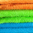 Background of the three multi colored terry towels — Photo