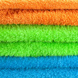 Background of the three multi colored terry towels - Стоковая фотография