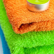 Background of the three multi colored terry towels and candle - Foto de Stock
