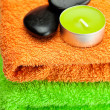 Background of the three multi colored bath towels, spa black sto - Stockfoto