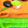 Background of the three multi-colored bath towels, black spa sto - 