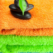 Background of the three multi-colored terry towels and spa black - Stockfoto