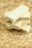 Sweet wafers lying on a wicker mat — Stock Photo
