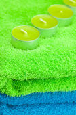 A few candles lying on the towel — Stock Photo