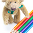 Teddy Bear and colored pencils isolated on white — Stock Photo