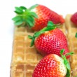 Big juicy ripe strawberries and waffles isolated on white — Foto de Stock