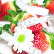 Background of red big juicy ripe strawberry and flower — Stock Photo #6133632