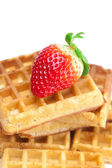 Big juicy ripe strawberries and waffles isolated on white — Stock Photo