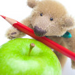 Stock Photo: Teddy bear, apple and colored pencils isolated on white