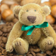 Stock Photo: Teddy bear with a bow, coffee beans and nuts