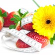 Background of red big juicy ripe strawberry and flower - Stockfoto
