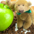 Teddy bear with a bow,apple and coffee beans — Stock Photo
