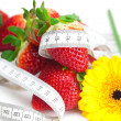 Background of red big juicy ripe strawberry and flower — Stock Photo #6142559