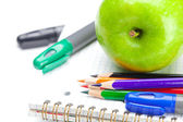 Apple, notebooks and pencils isolated on white — Stock Photo